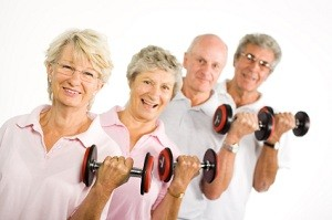 A group of older people lifting weights