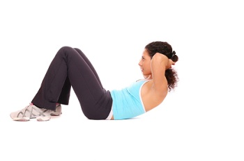 A woman doing situps