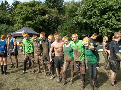 group of people completing tough mudder