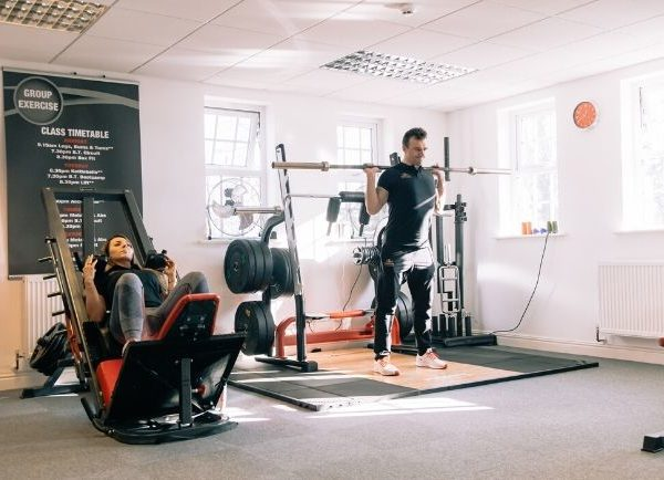 woman and man training legs at local Ribble Valley gym