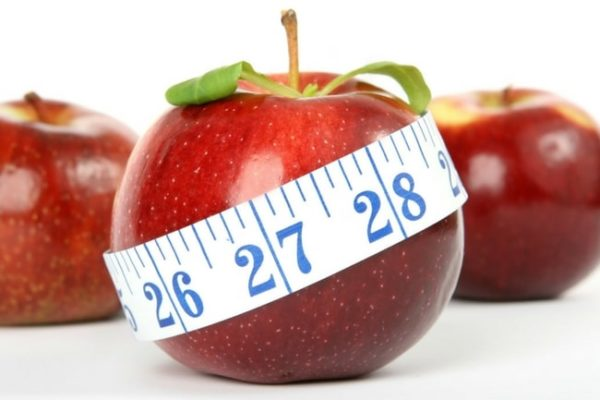 a fat apple with a tape measure around