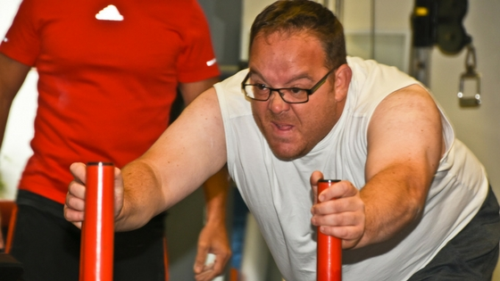 fat man doing fitness classes at the gym
