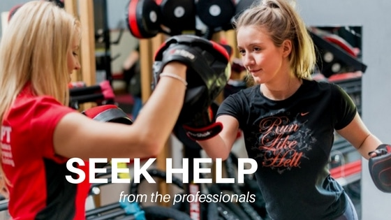 female personal training client with a female personal trainer boxing to lose weight
